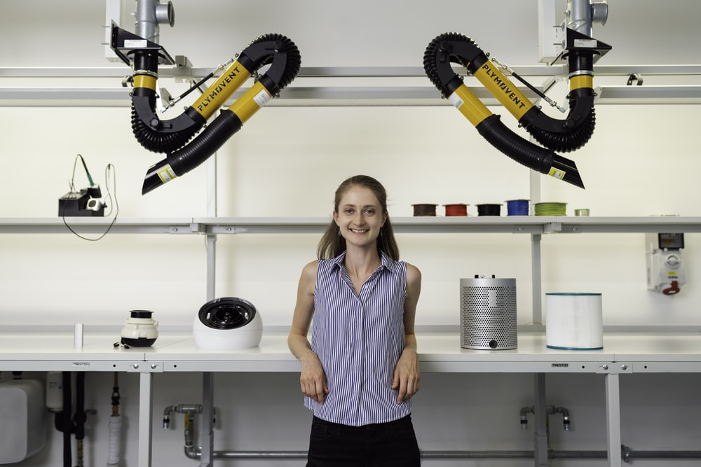 woman in blue sleeveless shirt holding black and yellow power tool