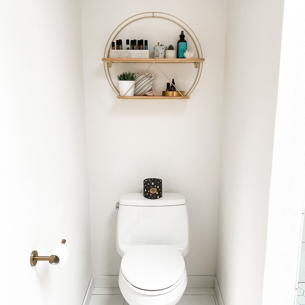 white ceramic sink with faucet