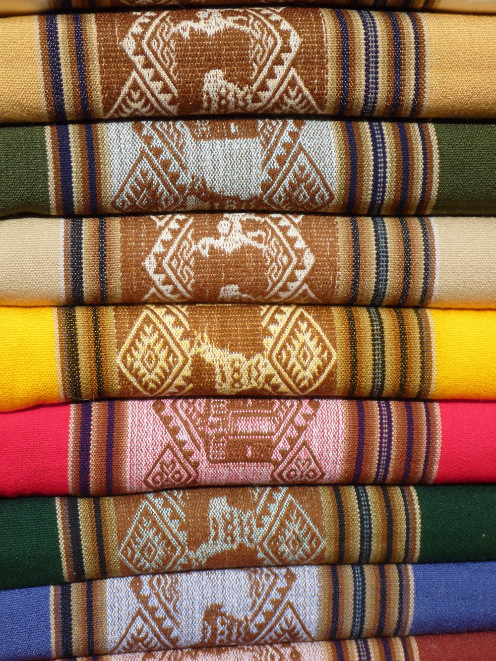 red green and brown textile