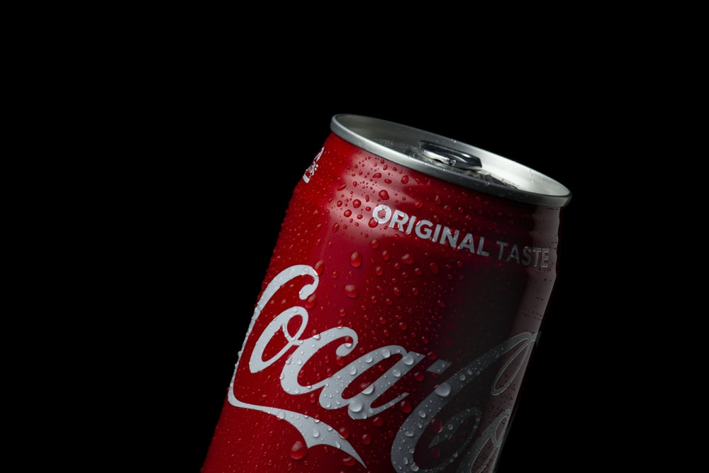 coca cola can on black background