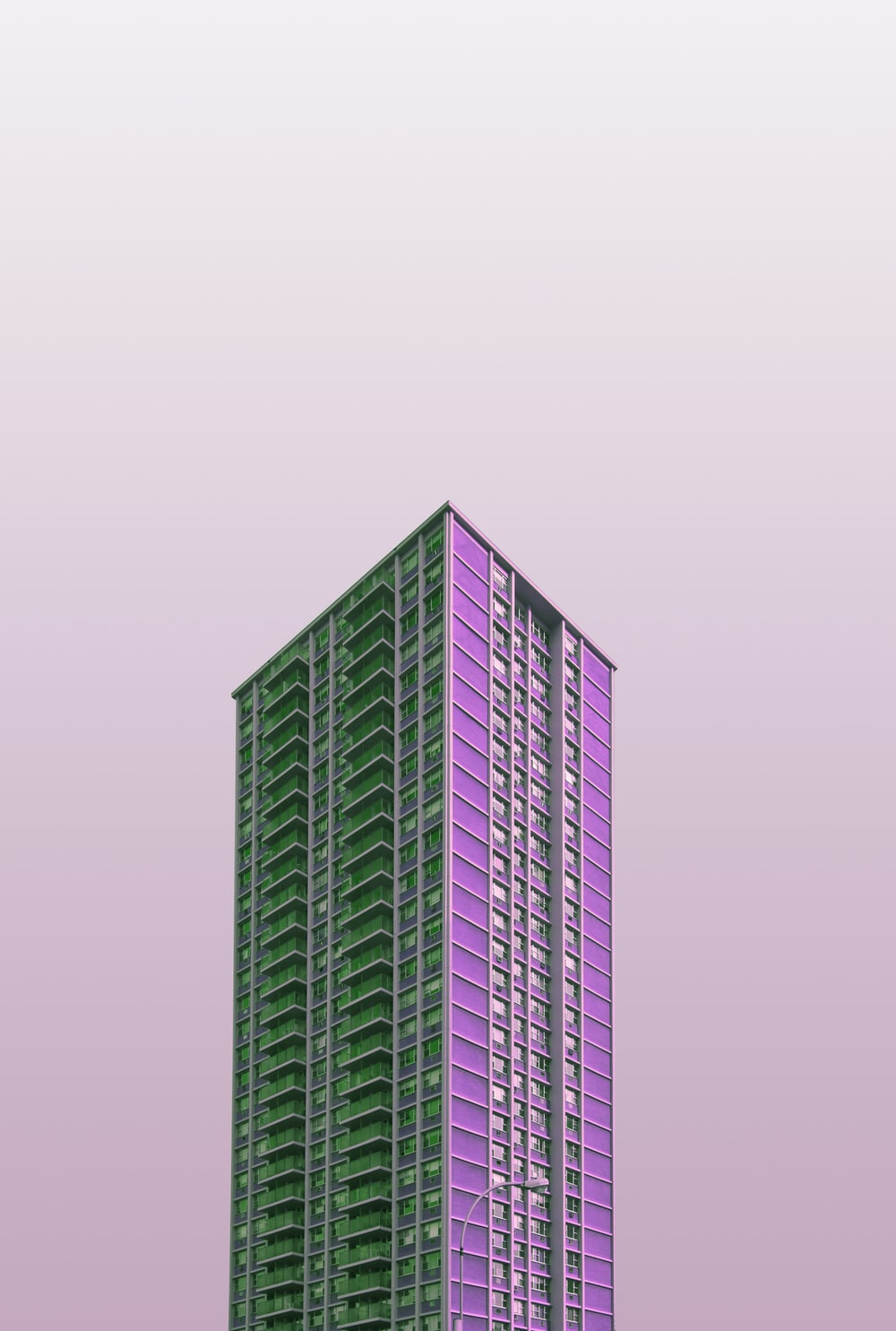 green and white high rise building