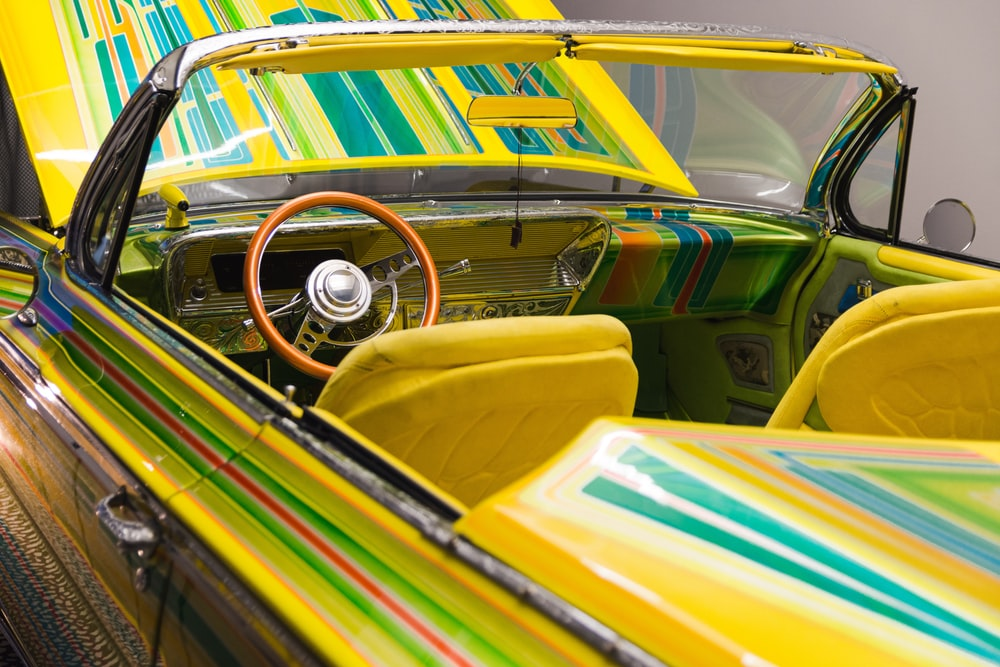 yellow and green vintage car