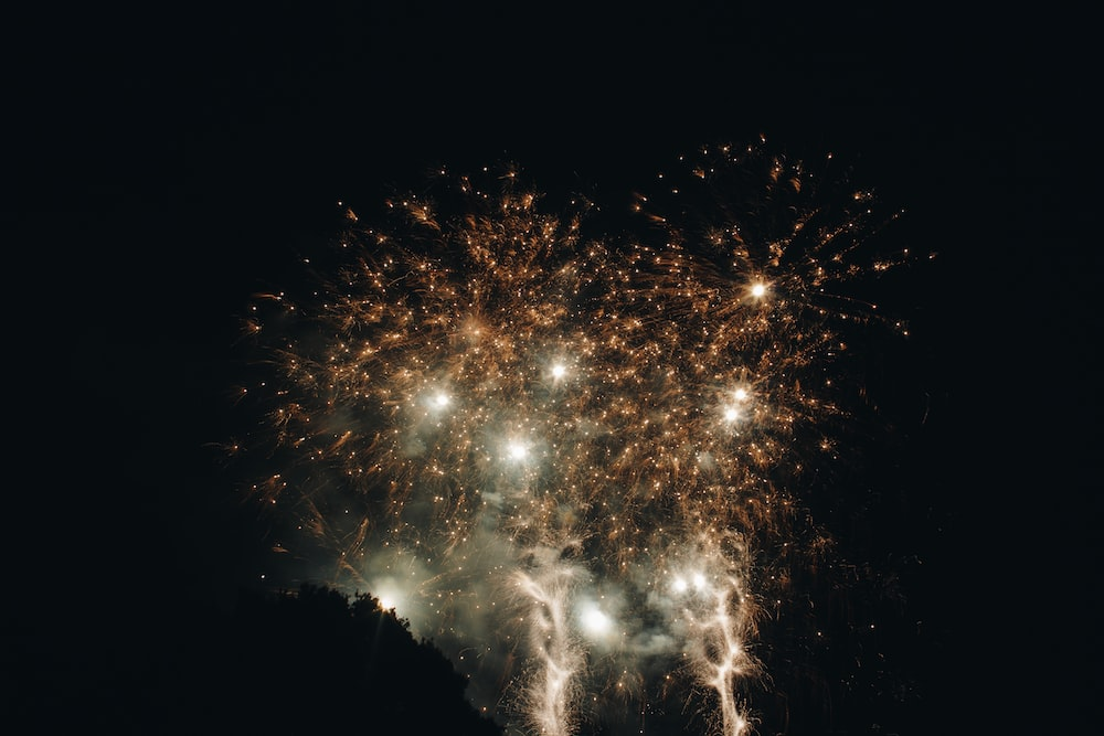 white and yellow fireworks during nighttime