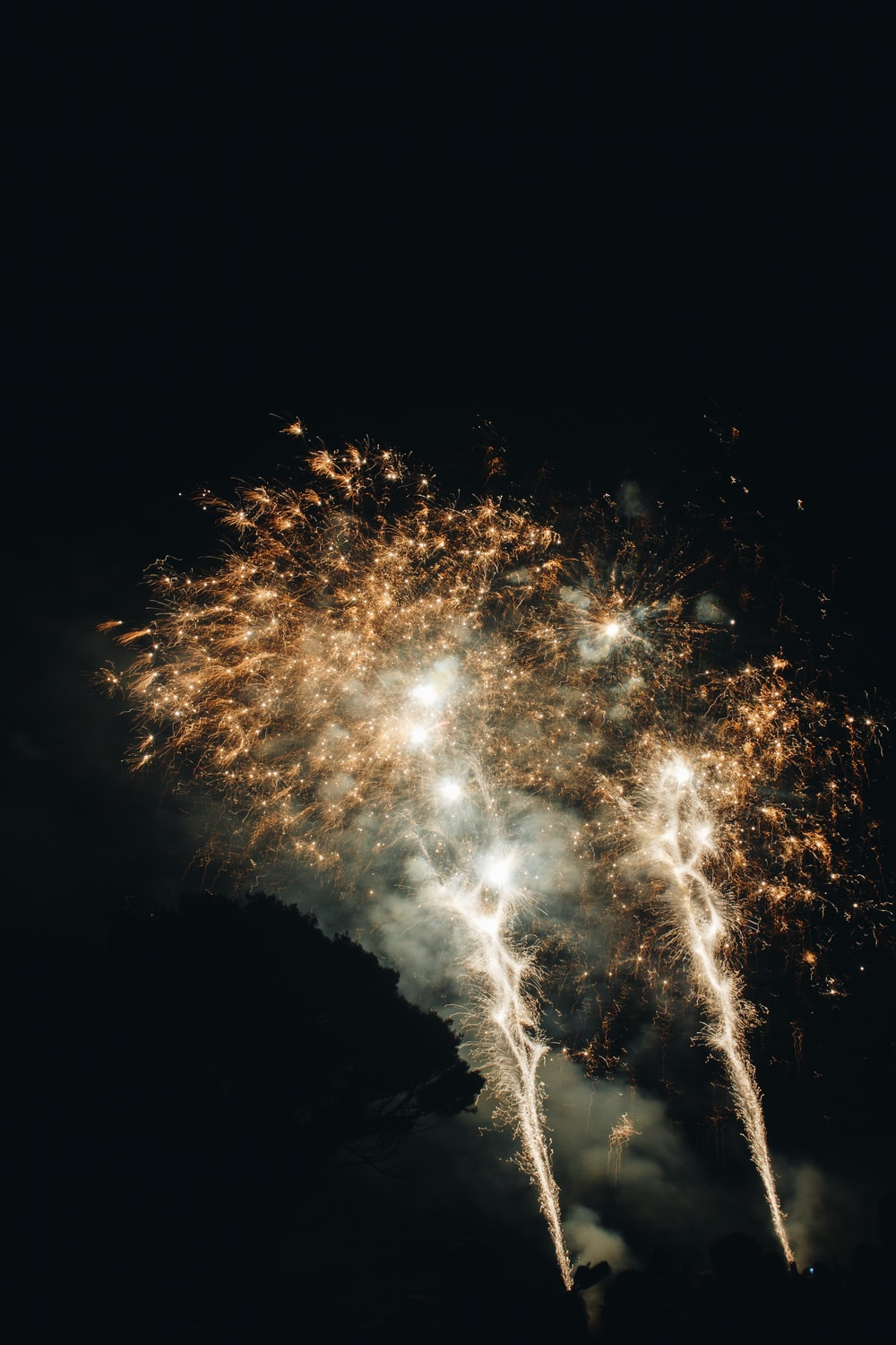 white fireworks in the sky during night time
