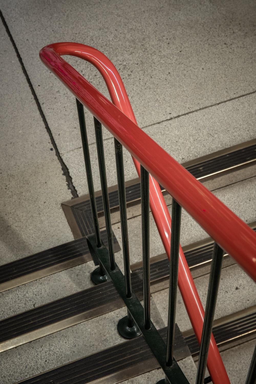 red metal railings on gray concrete floor