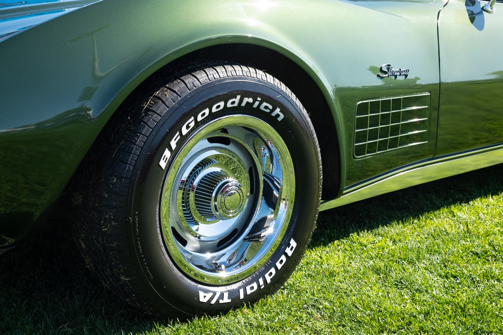 gray mercedes benz car on green grass field during daytime