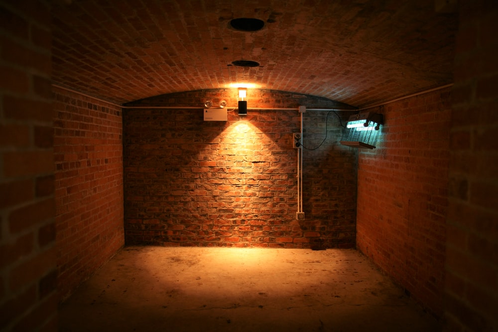 brown brick wall with light bulb