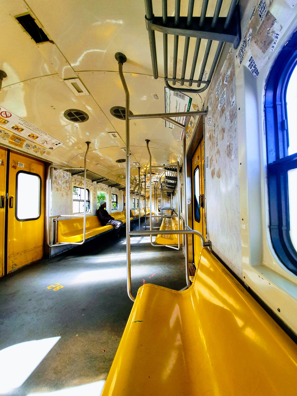 yellow and blue train in train station