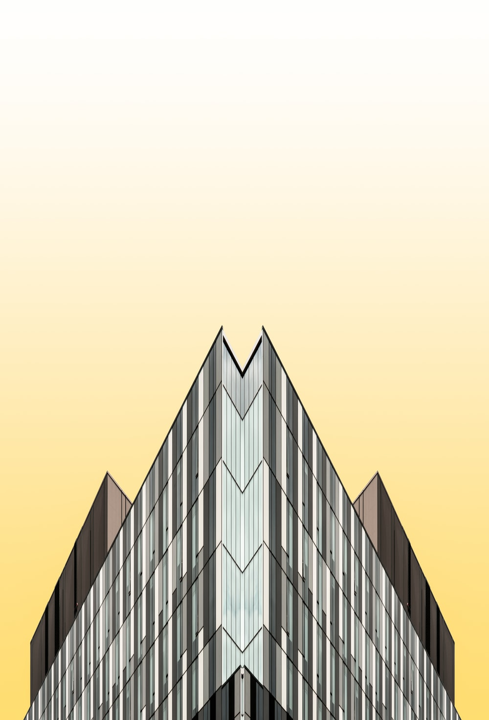black and yellow glass walled building