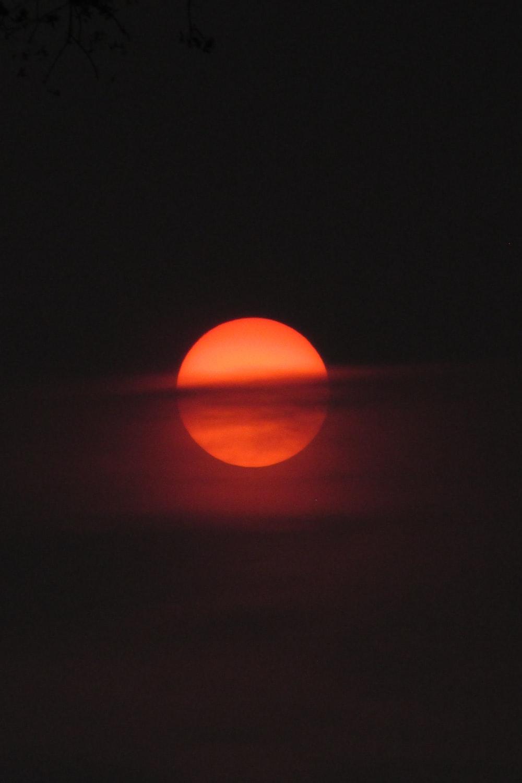 orange round ball on black surface