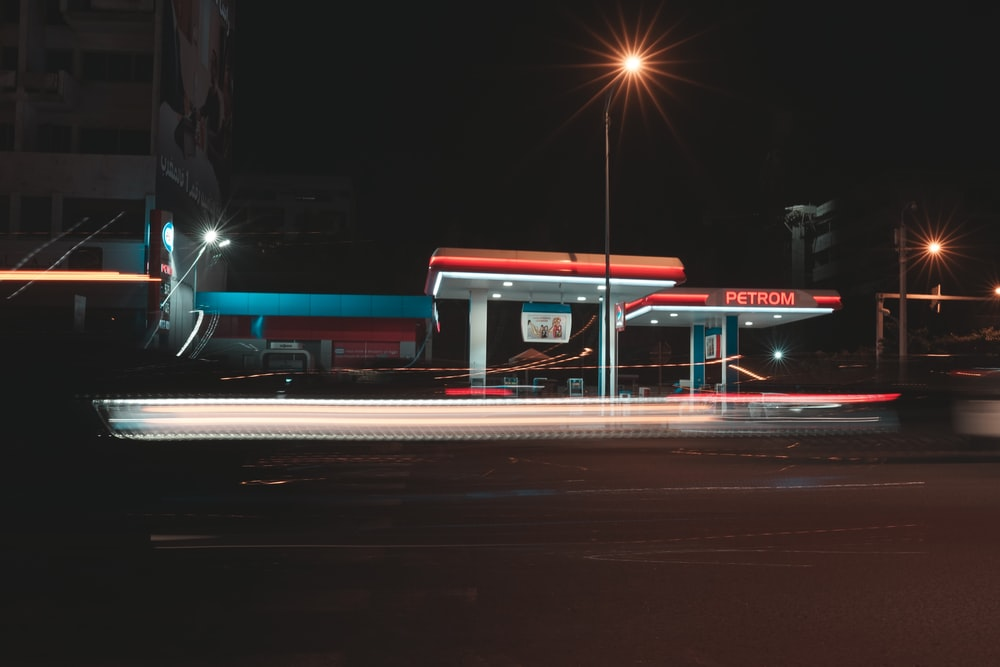 blue and red bus on road during night time