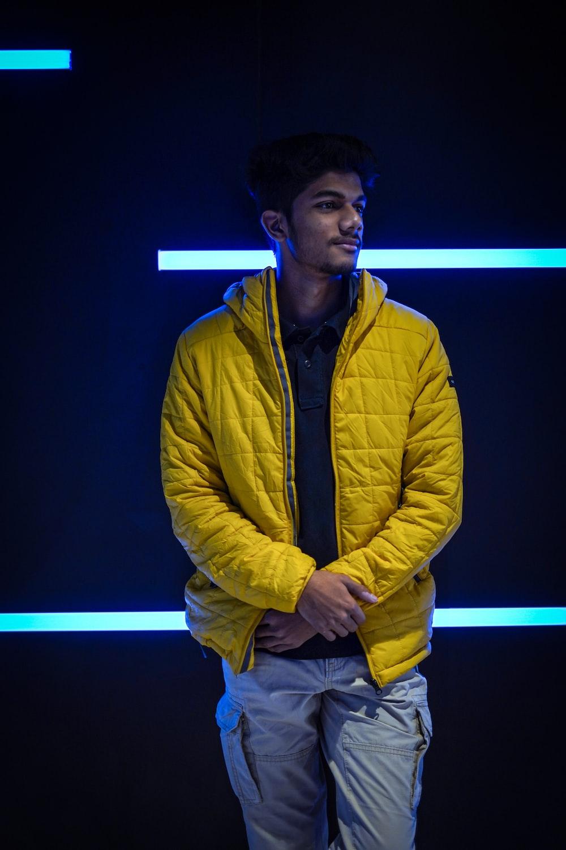 man in yellow zip up jacket