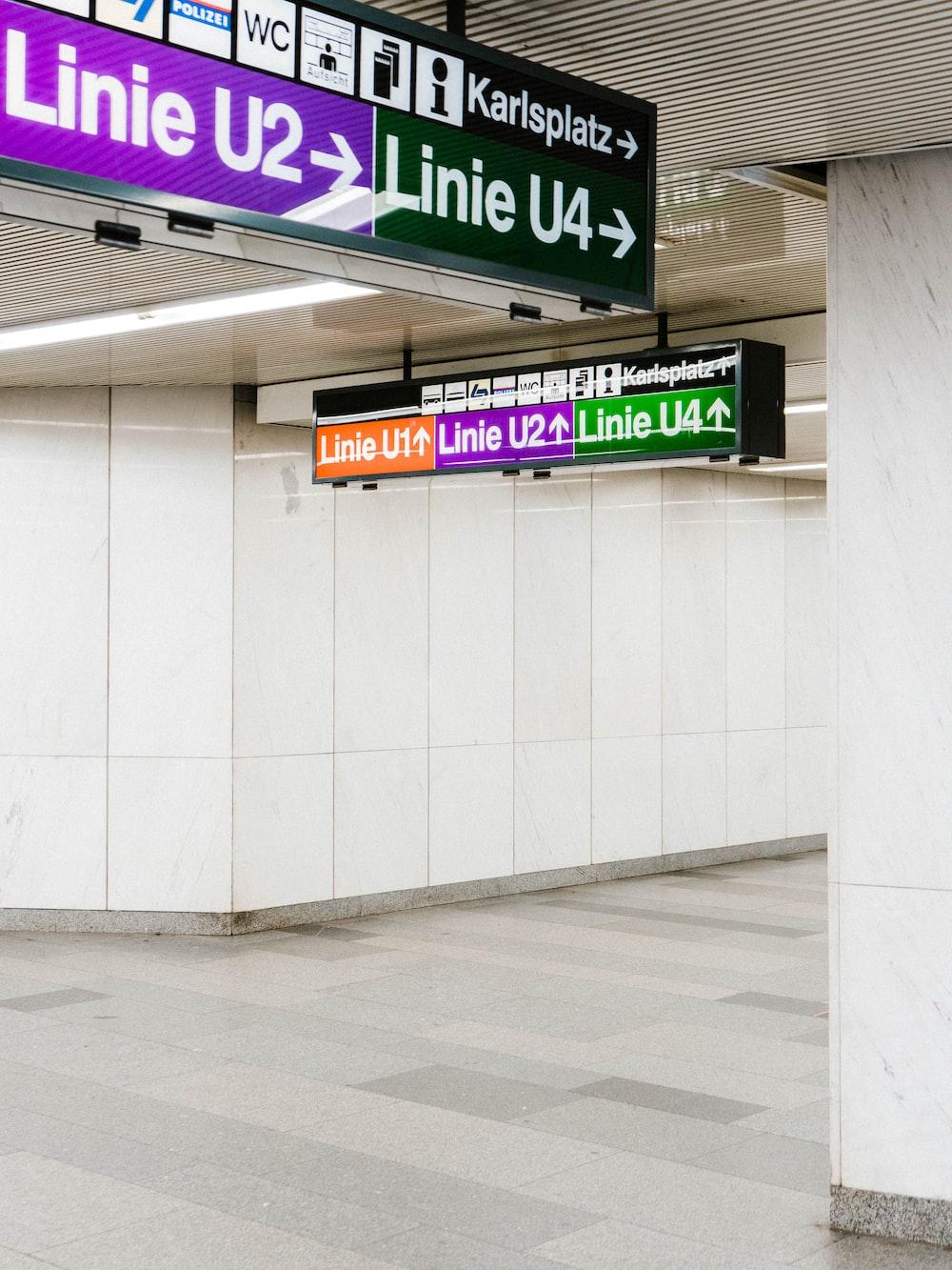 purple and white kanji text signage