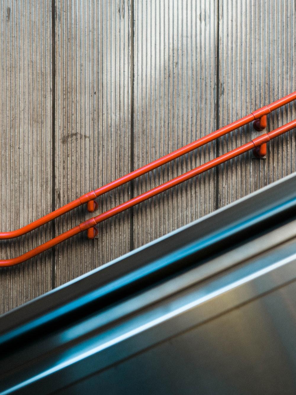 orange and black metal railings