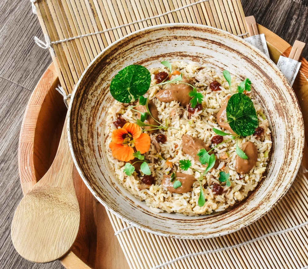 brown wooden bowl with food