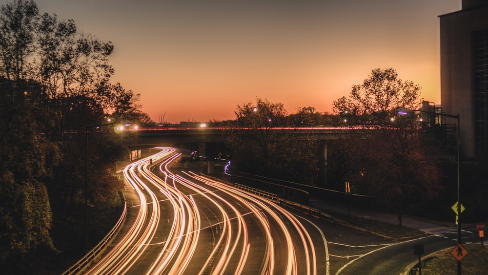 time lapse photography of cars on road during sunset