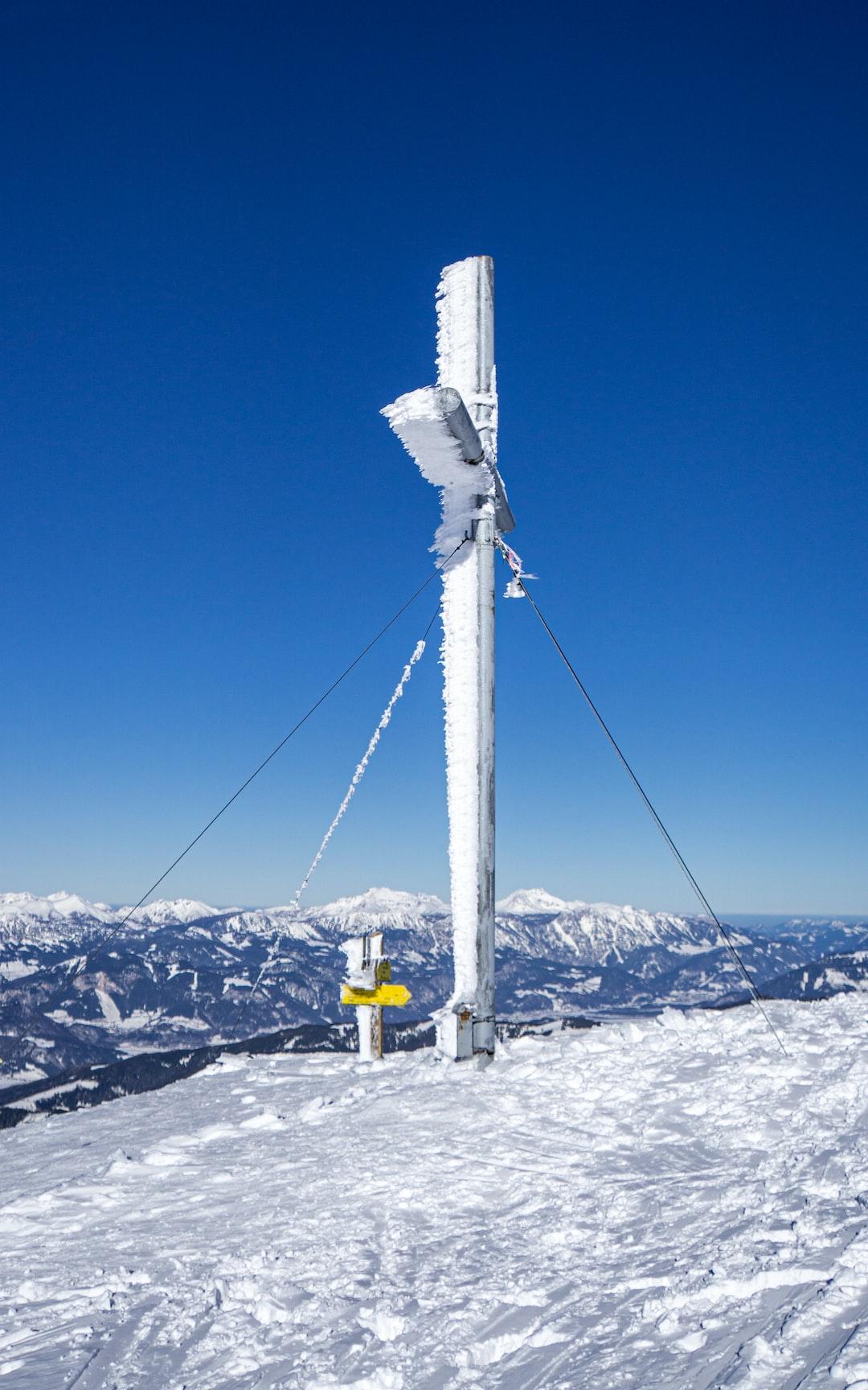Summit cross of the Gumpeneck in winter
