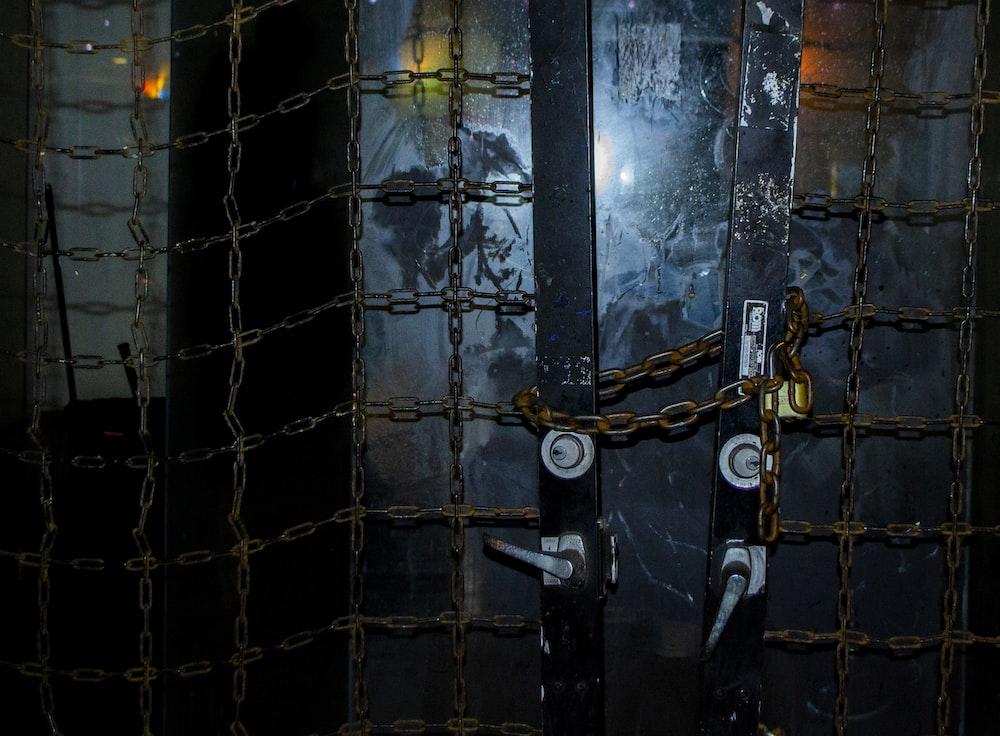 black metal door with padlock