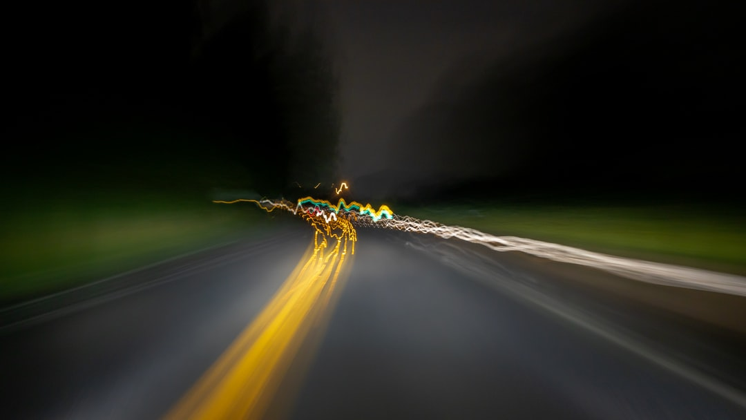 dark chaotic driving with yellow blurred road lines green sides