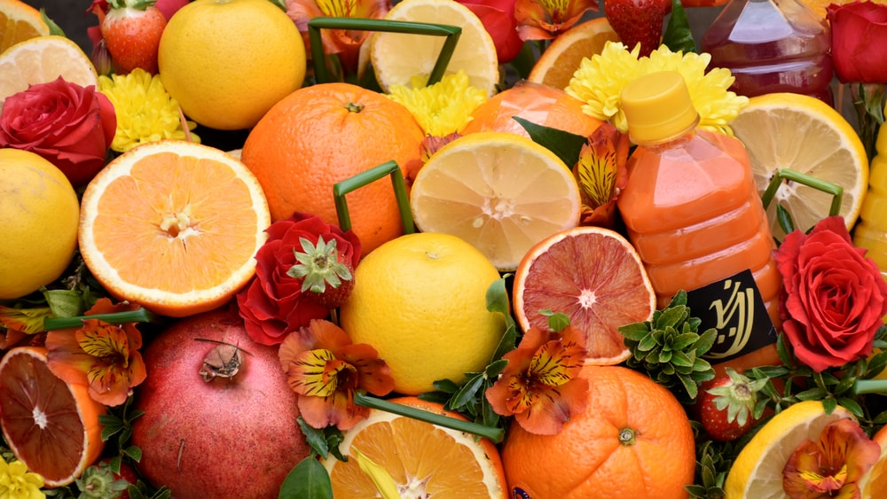 sliced lemon fruit and orange fruit