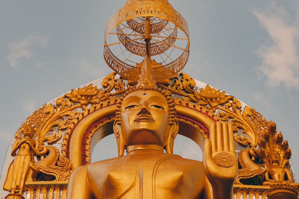 gold statue under blue sky during daytime