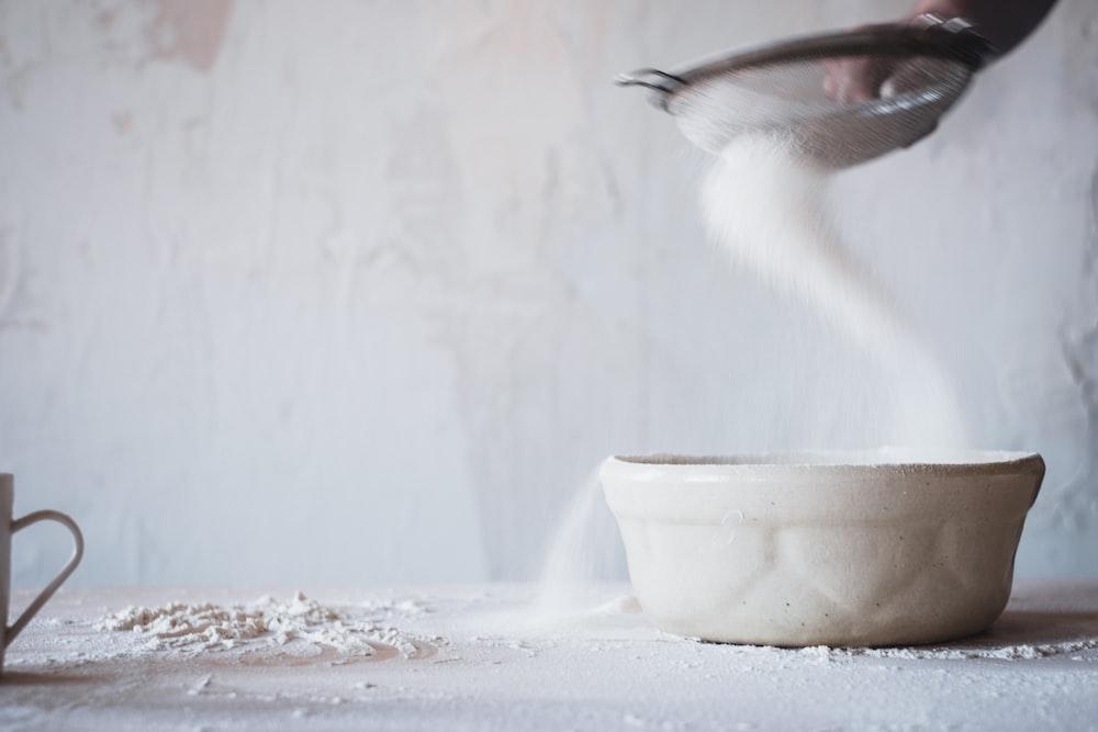 white and black bird on white ceramic bowl