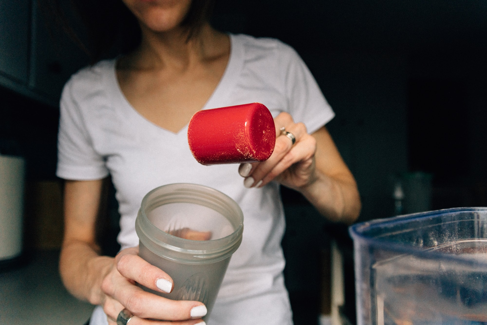 Morning Routine: Pouring protein shake powder into a cup