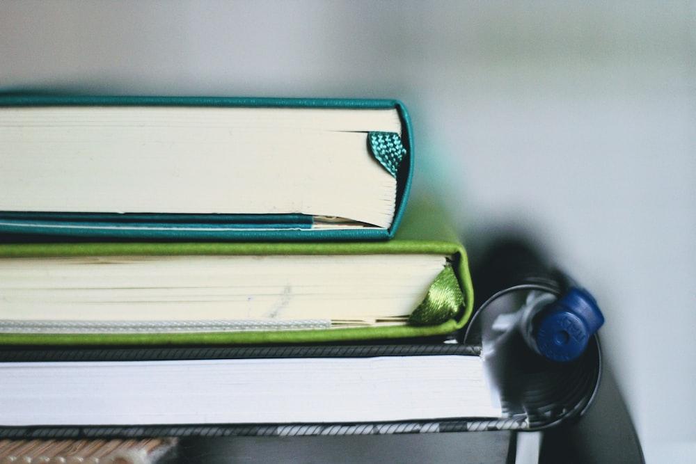 blue pen on green book