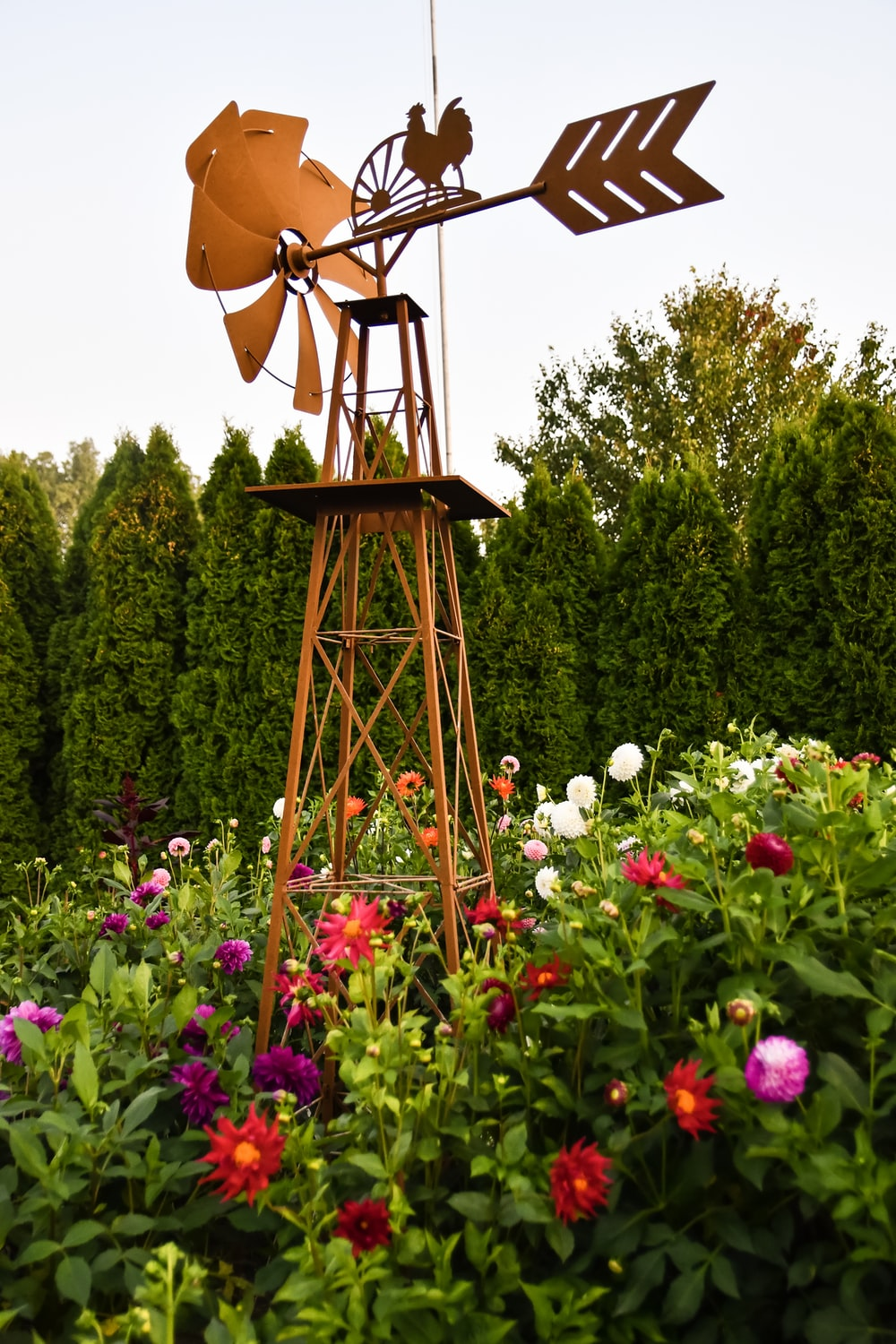 brown wooden tower with flowers and trees