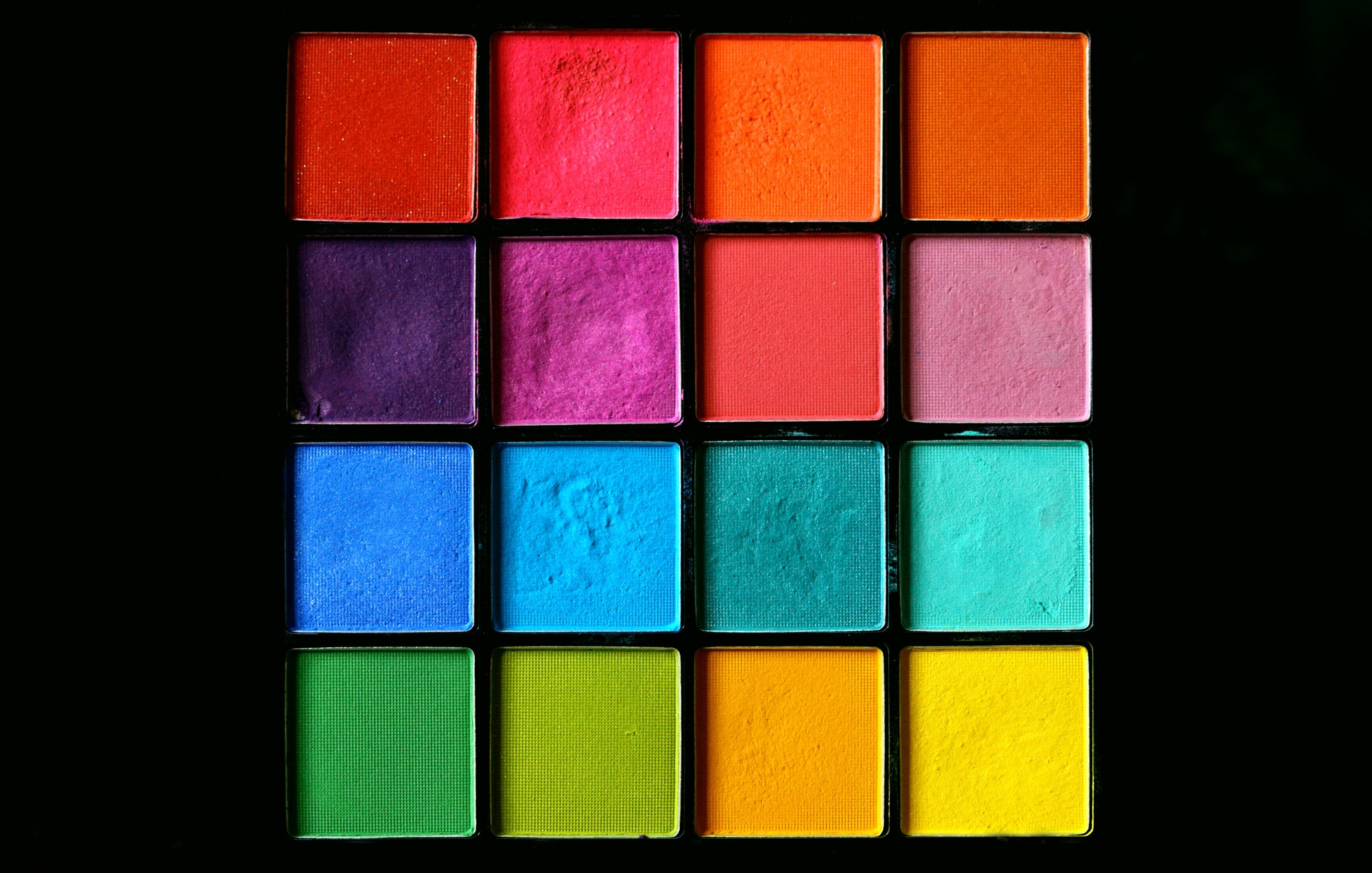 Rainbow pressed powder eye shadow make-up palette.