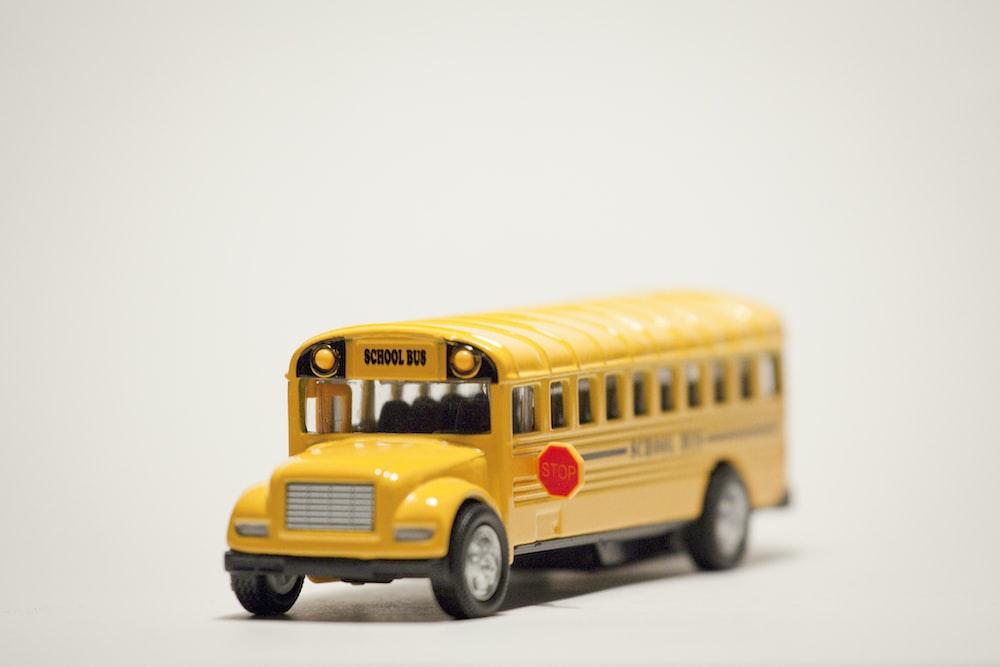 yellow school bus on white background