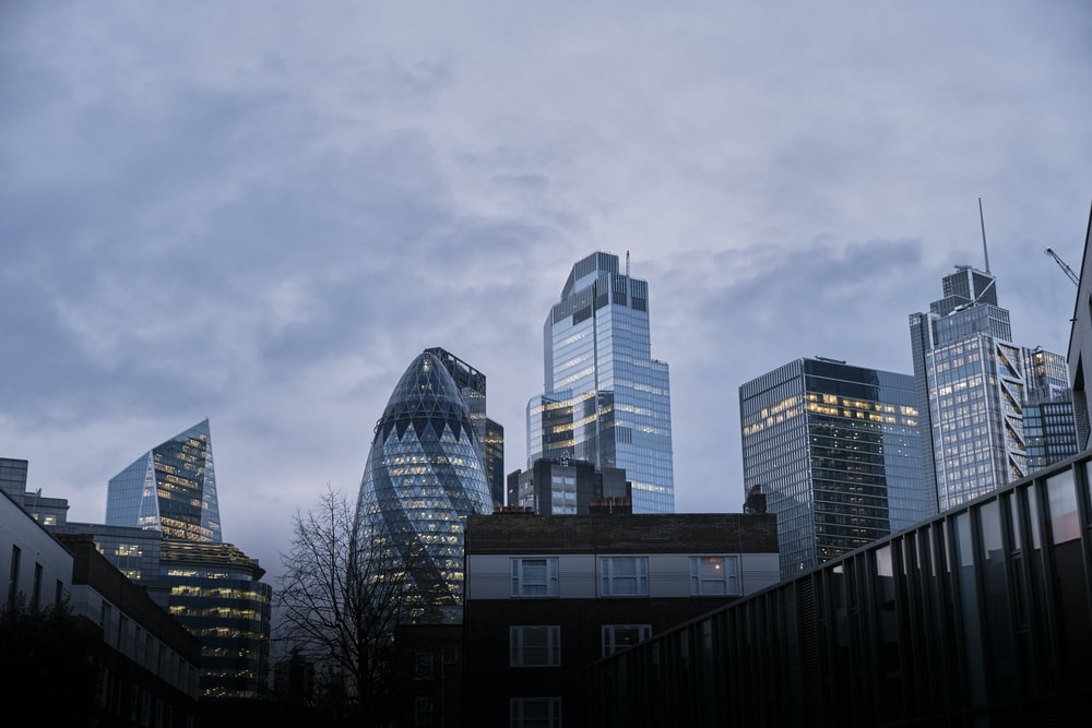 high rise buildings under gray sky