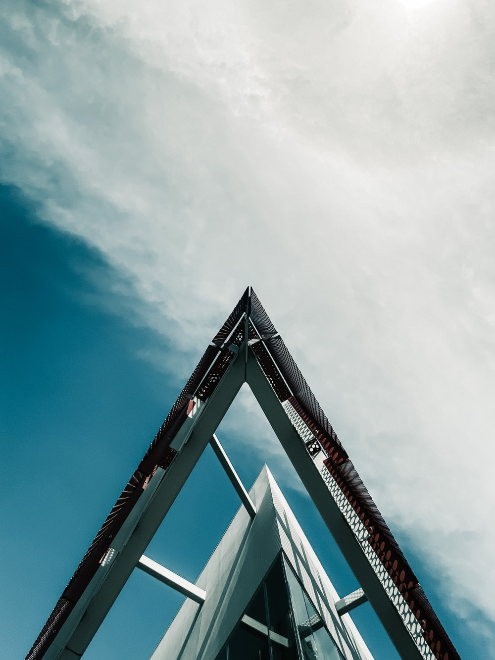 low angle photography of red and white building