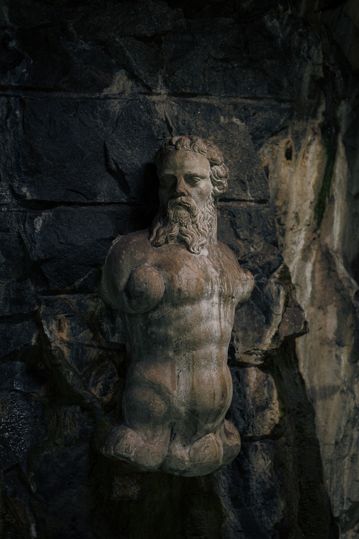 brown concrete statue of man
