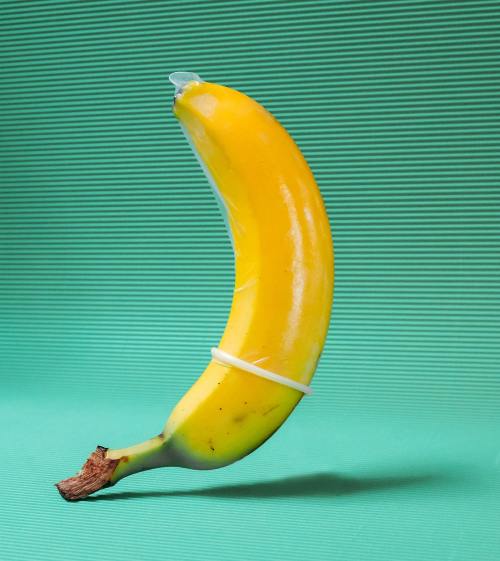 A yellow banana wrapped in a condom.