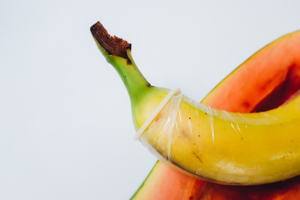 yellow banana fruit on white surface