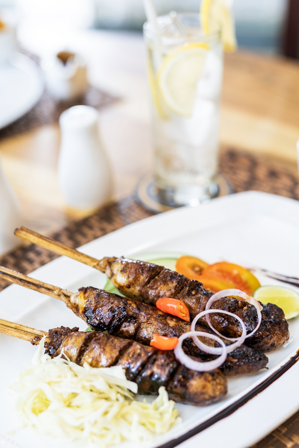 grilled meat with sauce on white ceramic plate