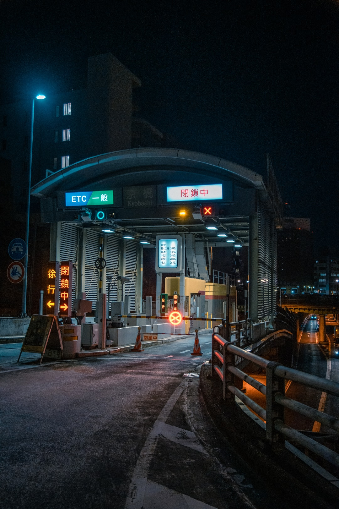 A toll gate at night in Ginza, district of Tokio, Japan