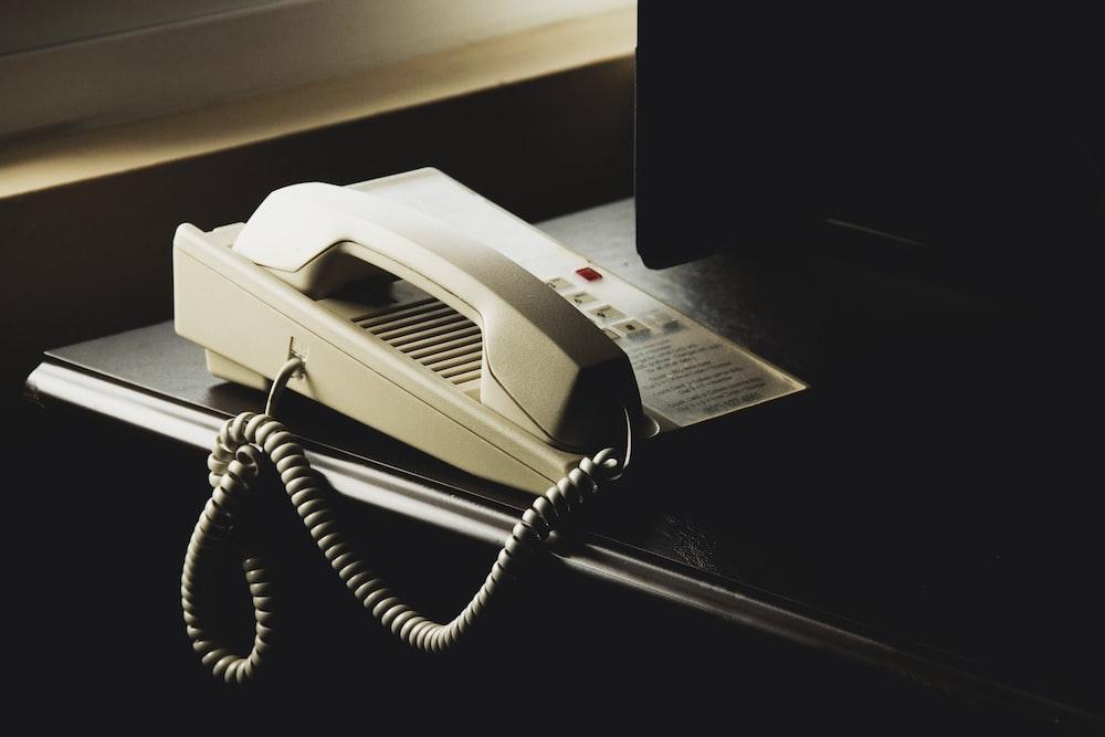 white and black ip desk phone