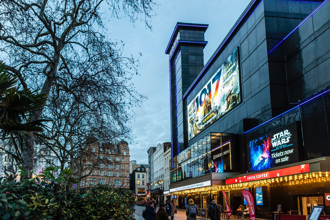 London, Leicester Square, UK - Views from the square, people, buildings, architecture, Odeon Luxe movie theater.