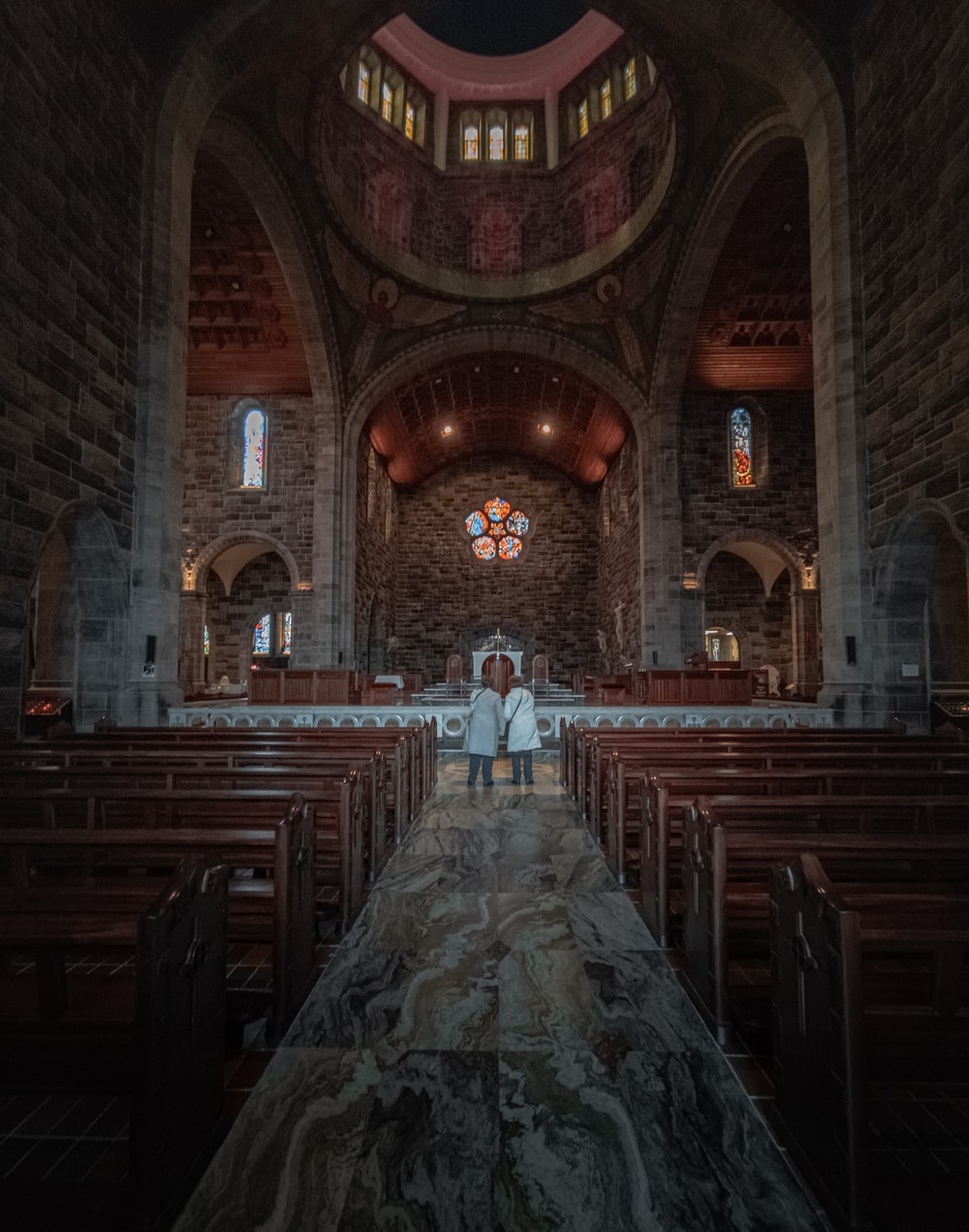 brown wooden chairs inside church