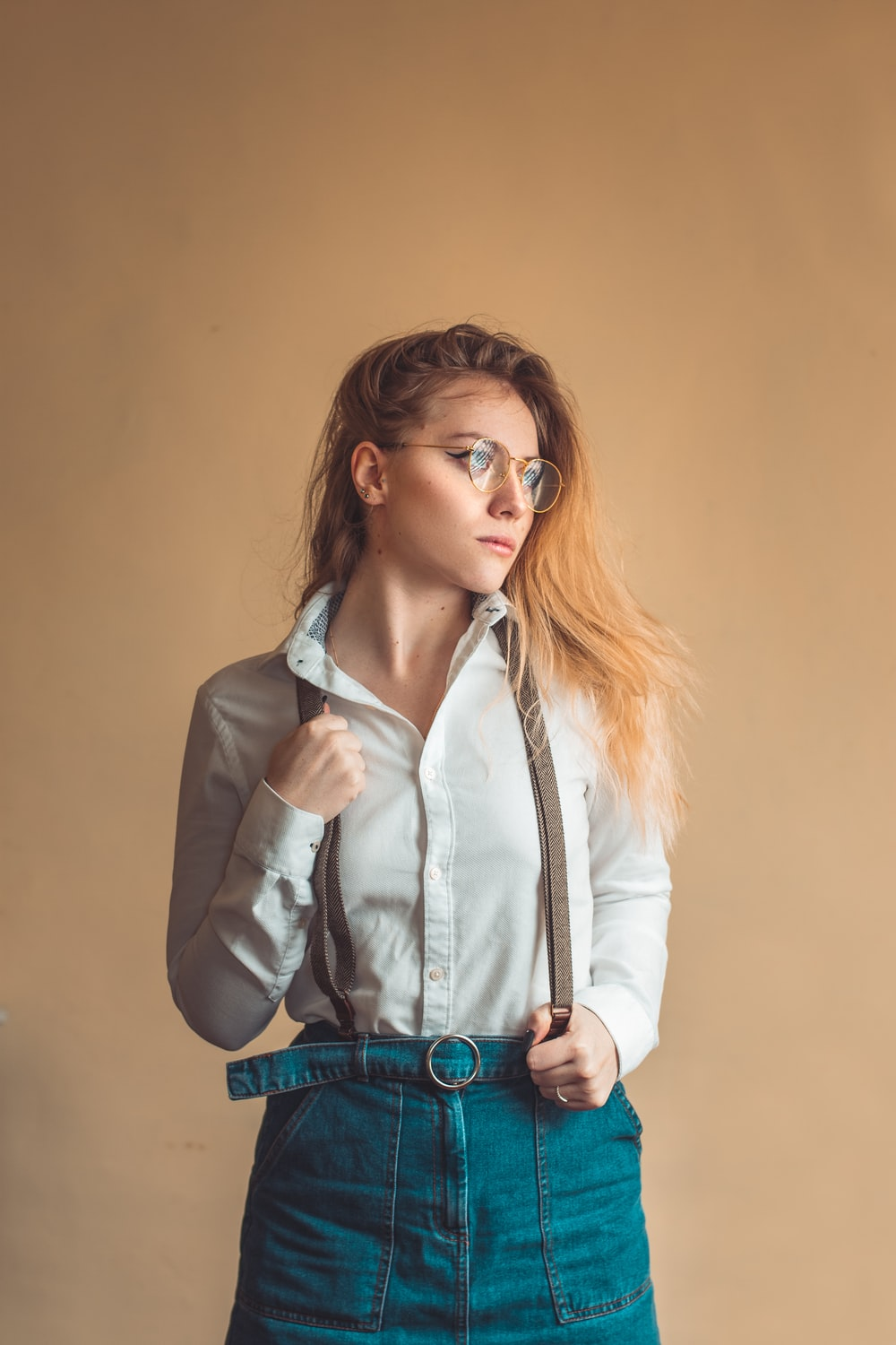 woman in white button up long sleeve shirt and blue denim jeans