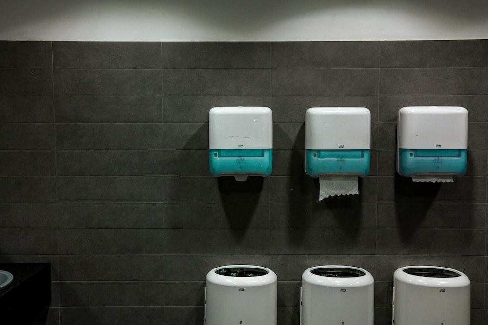white toilet paper roll on white toilet paper holder
