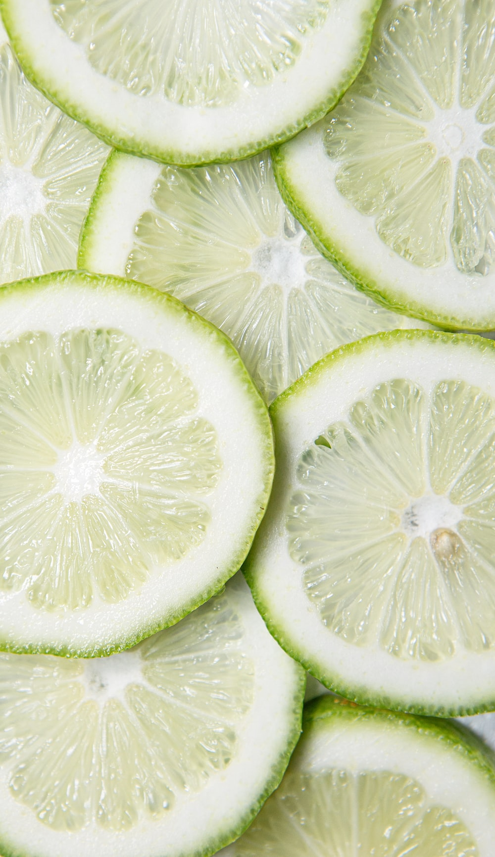 sliced green lime on brown wooden table
