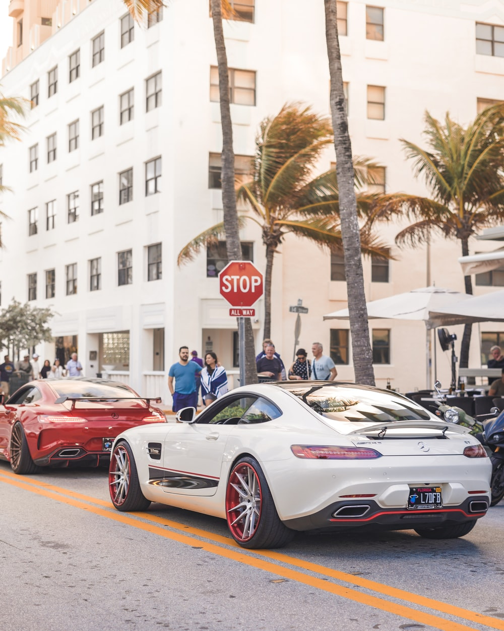 red and white porsche 911 parked on street during daytime