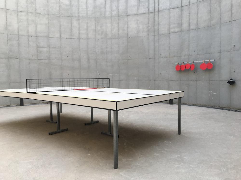 white table near gray wall