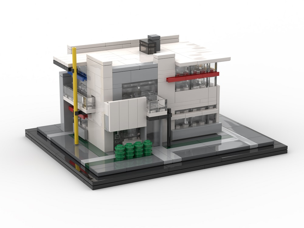 white and black building miniature