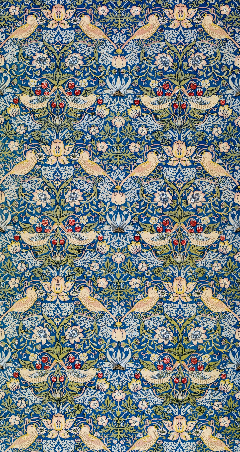 blue white and brown floral textile