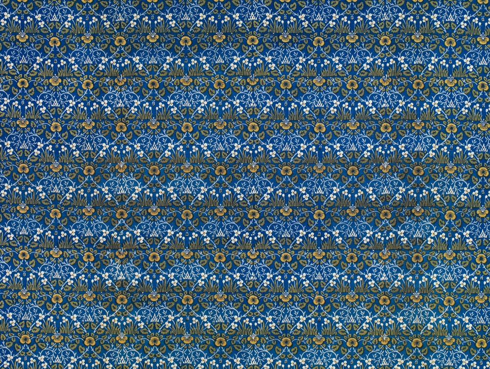 blue and yellow floral textile