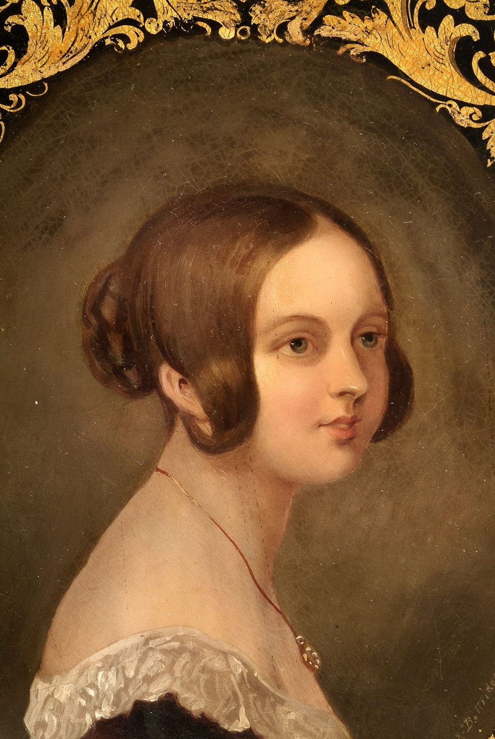 woman with brown hair painting